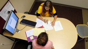Career peer Marina Kopylova, top, helps out Bei-Min L. Hoffnagle with her resume in hopes of finding a job, at the Arizona State University Polytechnic campus in Mesa, Arizona, Thursday, Oct. 7, 2010. (AP / Ross D. Franklin)