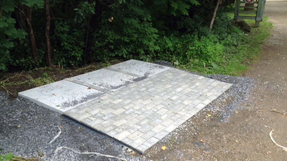 Canada Post gave no notice before pouring this concrete slab at L'Anse a L'Orme park in Pierrefonds, and that has infuriated Montreal-area mayors (CTV Montreal/Tania Krywiak)