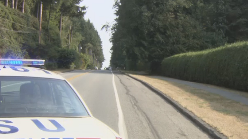 A police car sits on a highway in Surrey, B.C. on Aug. 12, 2015.