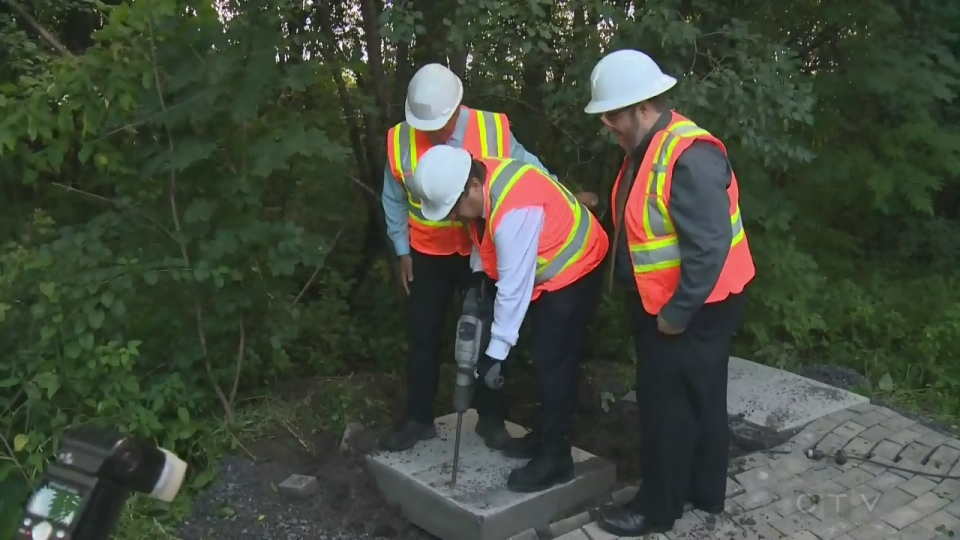 Montreal Mayor Denis Coderre brought in a jackhammer to get rid of the beginnings of a community mailbox in a Pierrefonds park.