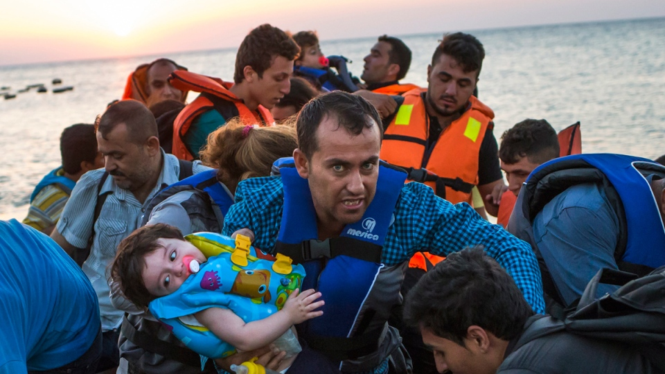 Migrants arrive at Kos, Greece, after crossing from Turkey, on Aug. 13, 2015. (Alexander Zemlianichenko / AP)