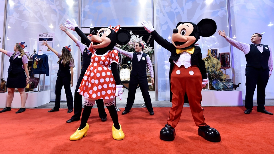 Disney Store at D23 Expo officially opens with a little help from Mickie Mouse and Minnie Mouse on Friday, August 14, 2015 in Anaheim, Calif. (AP / Disney / Jordan Strauss)