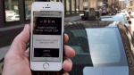 The ride-hailing app Uber is shown on a smartphone in Montreal, Thursday, May 14, 2015. (Ryan Remiorz / THE CANADIAN PRESS)