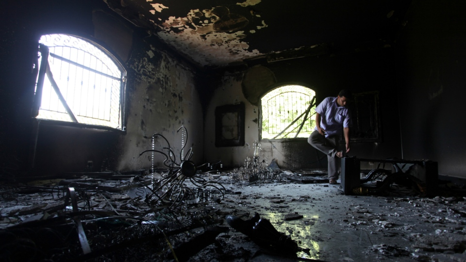 A Libyan man investigates the inside of the U.S. Consulate after an attack that killed four Americans, including Ambassador Chris Stevens, on the night of Tuesday, Sept. 11, 2012, in Benghazi, Libya, in this photo taken on Sept. 13, 2012. (AP / Mohammad Hannon)