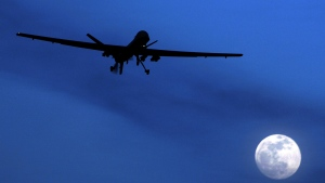 An unmanned U.S. Predator drone flies over Kandahar Air Field, southern Afghanistan on a moonlit night on Jan. 31, 2010. (AP / Kirsty Wigglesworth)