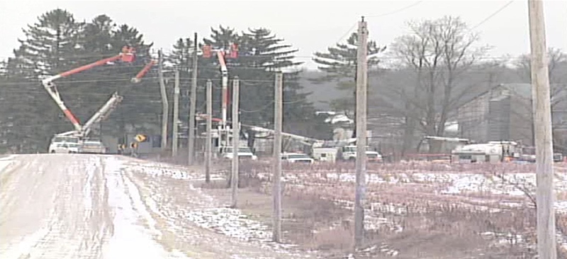 Hydro crews work in a field where a vehicle collided with a hydro pole after a police pursuit near Wroxeter, Ont. on Dec. 5, 2014. (Scott Miller / CTV London)