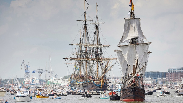 Tall ships escorted by small boats arrive in Amsterdam, Netherlands, to participate in SAIL Amsterdam 2015, Wednesday, Aug. 19, 2015. (AP / Phil Nijhuis)