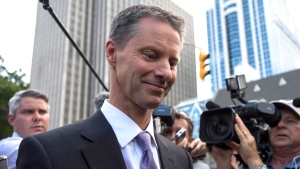 Nigel Wright, former Chief of Staff to Prime Minister Stephen Harper, leaves the courthouse in Ottawa following his sixth day of testimony at the trial of Mike Duffy on Wednesday, Aug. 19, 2015.  (Justin Tang / THE CANADIAN PRESS)