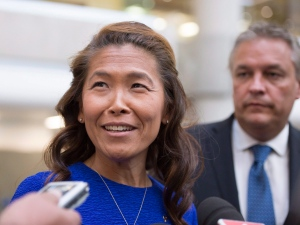 Lu Chan Khuong, the suspended head of the Quebec Bar association, arrives at the courthouse with her lawyer Jean-Francois Bertrand Thursday, August 20, 2015 in Quebec City. (Jaques Boissinot/THE CANADIAN PRESS)