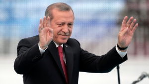 In this Saturday, May 30, 2015 photo, Turkey's President Recep Tayyip Erdogan waves to the crowds in Istanbul, Turkey, during a rally to commemorate the anniversary of city's conquest by the Ottoman Turks. (Lefteris Pitarakis/AP Photo, File)
