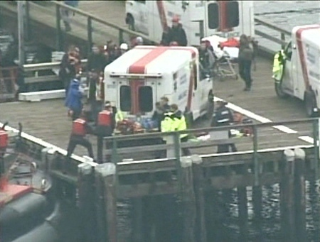 The sole survivor of a plane crash in B.C. is transferred to an ambulance after being transported to Halfmoon Bay by the Canadian Coast Guard for treatment, Sunday, Nov. 16, 2008.