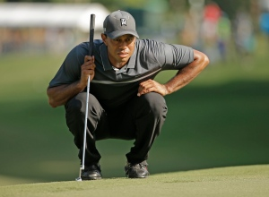 Tiger Woods lines up a putt on the 17th hole during the second round of the Wyndham Championship golf tournament in Greensboro, N.C., Friday, Aug. 21, 2015. (Chuck Burton/AP Photo)