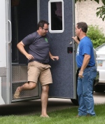 In this July 7, 2015 file photo, former Subway restaurant spokesman Jared Fogle leaves a mobile evidence-gathering lab outside of his home as Indianapolis Metropolitan Police Department Det. Darin Odier holds the door, in Zionsville, Ind. (Charlie Nye/The Indianapolis Star via AP)
