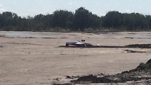 Overturned plane in a muddy field in Walden