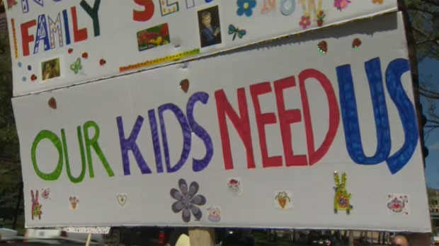 Sign at the International Day of Protest against Child Protection rally outside of Calgary City Hall