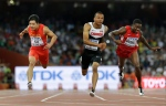 Canada's Andre De Grasse, middle, China's Su Bingtian, left, and United States' Trayvon Bromell compete in a men's 100m semifinal at the World Athletics Championships at the Bird's Nest stadium in Beijing on Sunday, Aug. 23, 2015. (AP / David J. Phillip)