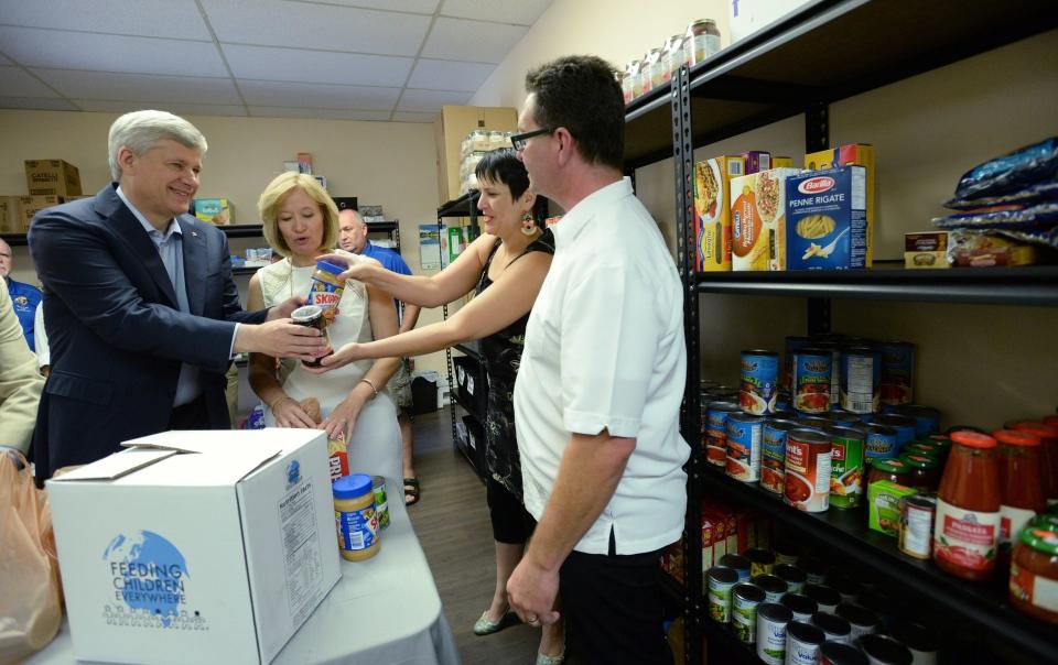 Harper promises service club tax credit