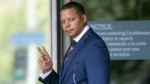 Actor Terrence Howard walks into a Los Angeles court for a hearing regarding a divorce settlement with his ex-wife Michelle Ghent on Aug. 13, 2015. (AP / Damian Dovarganes)