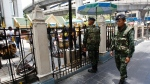 Thai soldiers walk outside the Erawan Shrine at Rajprasong intersection, the scene of last week's bombing, in Bangkok, Thailand, Monday, Aug. 24, 2015. (AP / Sakchai Lalit)