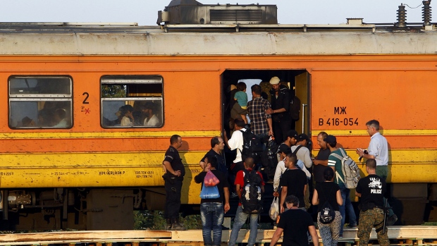 Migrants board a train towards Serbia
