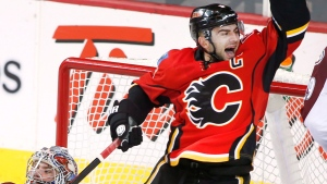 Calgary Flames' Mark Giordano, right, celebrates on Dec. 4, 2014. (Larry MacDougal / THE CANADIAN PRESS)