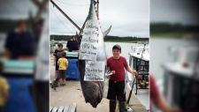 Boy catches big fish