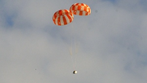 A test version of NASA's Orion spacecraft successfully landed under two main parachutes in the Arizona desert Wednesday, Aug. 26, 2015. (NASA)