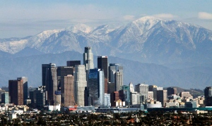 The snow-capped San Gabriel Mountains provide a backdrop to the downtown Los Angeles skyline as seen from Kenneth Hahn State Recreation Area in Baldwin Hills, Wednesday, Dec. 31, 2014. (AP/Nick Ut)