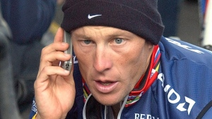 In this Monday, July 12, 2004, file photo, cyclist Lance Armstrong speaks on a cell phone in France. (AP Photo/Peter Dejong)