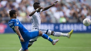 Montreal Impact's Johan Venegas, left, and Vancouver Whitecaps' Gershon Koffie vie for the ball during first half Canadian Championship final soccer action in Vancouver, B.C., on Aug. 26, 2015. (Darryl Dyck / THE CANADIAN PRESS)
