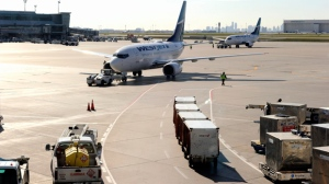 Baggage dollys and other vehicles await arriving airliners at Toronto Pearson International Airport Terminal 3 on October 22, 2012. (Dominic Chan)