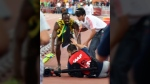 In this photo released by Xinhua News Agency, Jamaica's Usain Bolt gets up after he is rammed by a cameraman on a segway as he celebrates after winning the gold in the men's 200m final at the World Athletics Championships at the Bird's Nest stadium in Beijing, Thursday, Aug. 27, 2015. (Yue Yuewei / Xinhua via AP)