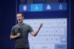 In this March 25, 2015 file photo, Mark Zuckerberg talks about the Messenger app during the Facebook F8 Developer Conference in San Francisco. (Eric Risberg/AP Photo)