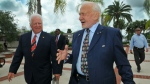 Florida Tech President and CEO Anthony J. Catanese, left, talks with Apollo 11 astronaut Buzz Aldrin as he shows him the campus before a signing ceremony formalizing the establishment of the Buzz Aldrin Space Institute at the university in Melbourne, Fla. on Aug. 27, 2015. (Craig Rubadoux / Florida Today)