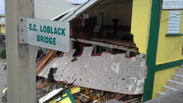 The Beran protestant church is partially collapsed due to Tropical Storm Erika in Roseau, Dominica on Aug. 27, 2015. (AP / Carlisle Jno Baptiste)