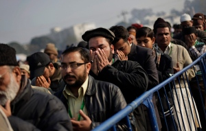 Ahmadiyya Muslims pray as they wait to enter the venue of their annual conference in Qadian, India, in this file photo from Monday, Dec. 26, 2011. (AP / Altaf Qadri)