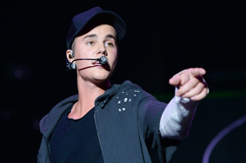 In this Sunday, Aug. 23, 2015 file photo, recording artist Justin Bieber performs at the 2015 Billboard Hot 100 Music Festival at Nikon at Jones Beach Theater in Wantagh, N.Y. (Photo by Scott Roth/Invision/AP, File)