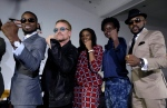 Irish rock star Bono, second left, poses with African music stars after a press conference in Lagos, Nigeria, Friday, Aug. 28, 2015. (AP/Sunday Alamba)