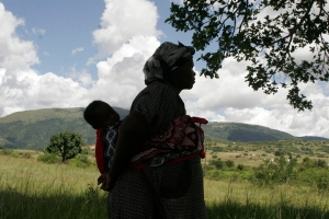 In this file photo, a Swazi woman carries a child on her back in Swaziland's Egebeni district on March 4, 2009. (AP / Denis Farrell)