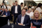 Outgoing Greek Prime Minister and the Syriza party leader Alexis Tsipras, second right, sits next to Regional Government of Attica Rena Dourou at a gathering of his party members in Athens, on Saturday, Aug. 29, 2015. (AP / Petros Giannakouris)