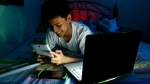 Screen time before bed has become pervasive and a new study suggests it could be particularly detrimental for children and young teens. (junpinzon / shutterstock.com)