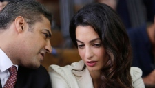 Mohamed Fahmy and Amal Clooney