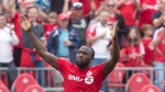 Toronto FC 's Jozy Altidore celebrates after scoring his team's second goal during second half MLS action against Montreal Impact in Toronto on Saturday August 29, 2015. THE CANADIAN PRESS/Chris Young