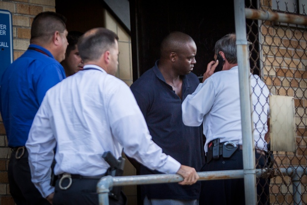 Shannon J. Miles, 30, is walked out of the Harris County Sheriff's Department in Houston on Saturday, Aug. 29, 2015. (Marie D. De Jesus / Houston Chronicle via AP)