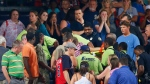 Rescue workers carry an injured fan from the stands at Turner Field during a baseball game between Atlanta Braves and New York Yankees, Saturday, Aug. 29, 2015, in Atlanta. (AP / John Bazemore)