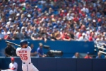 Toronto Blue Jays Russell Martin watches the flight of the ball as he hits a two-run homer off Detroit Tigers pitcher Alfredo Simon during fourth inning Major League baseball action in Toronto on Sunday, Aug. 30, 2015. (Chris Young / THE CANADIAN PRESS)
