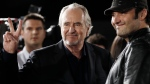 This April 11, 2011 file photo shows Director Wes Craven, left, and Robert Rodriguez posing together at the premiere of 'Scream 4' in Los Angeles. (AP / Matt Sayles)