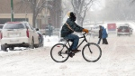 A cyclist pedals through the snow on Broadway Ave near Smith Street in Winnipeg, Tuesday, Dec.4, 2007.The forecast for the day was -11C with snow. THE CANADIAN PRESS/Winnipeg Free Press-Marc Gallant