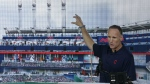 Cleveland Indians president Mark Shapiro points out the major renovations to right field at Progressive Field in Cleveland on Aug. 7, 2014. (AP / Tony Dejak)