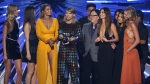 Taylor Swift, centre, accepts the award for video of the year for Bad Blood at the MTV Video Music Awards at the Microsoft Theater on Sunday, Aug. 30, 2015, in Los Angeles. Pictured from left are: Martha Hunt, Hailee Steinfeld, Gigi Hadid, Joseph Kahn, Lily Aldridge, Mariska Hargitay and Karlie Kloss. (Invision / Matt Sayles)